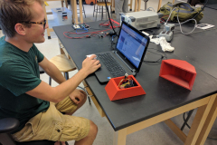 Aaron works on a remote environmental sensor for the Kidwell Lab.