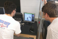 Students learn how to use the scanning electron microscope.