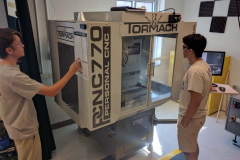 Students learning how to use the Tormach CNC Mill