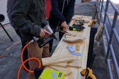 Students working together on woodworking